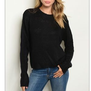 Black crewneck knit pull over sweater.